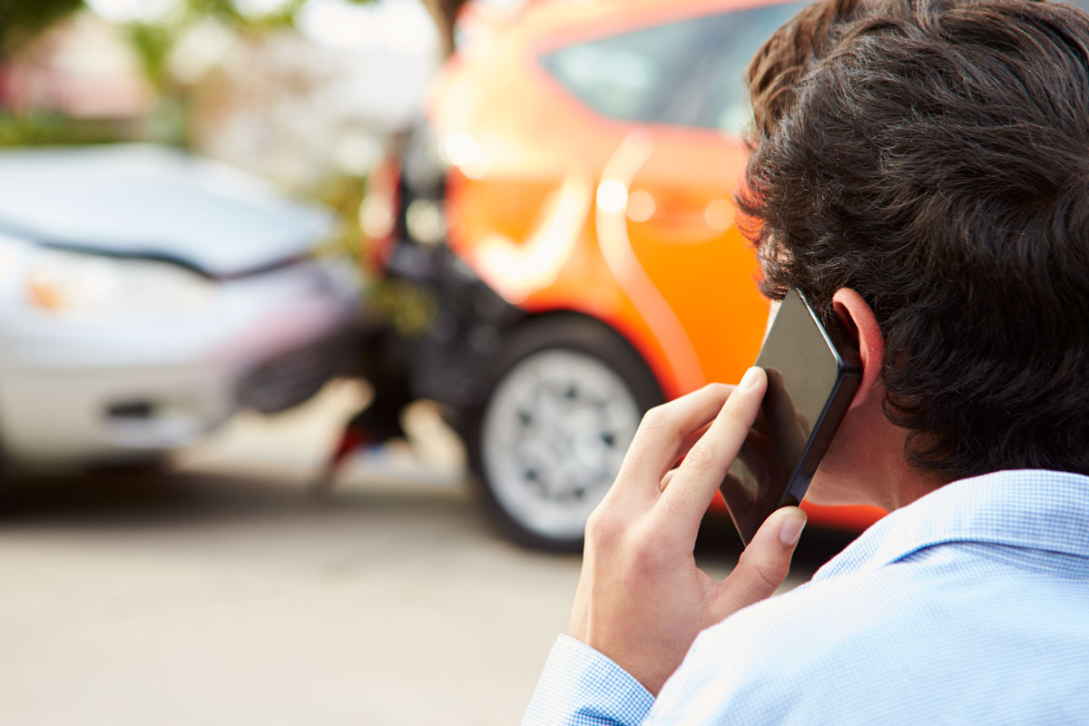 Person calling in car accident to insurance company in Tampa, FL