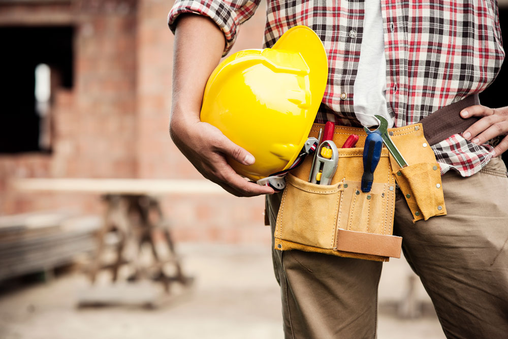 Construction worker on building site protected by commercial insurance